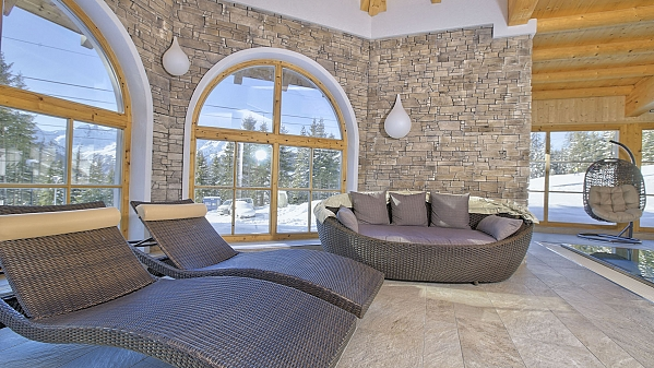 Stone veneer in the wellness and restaurant in Alpine hotel
